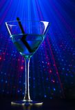Blue cocktail drink in a disco with space for text Royalty Free Stock Photos