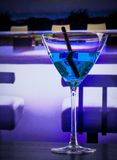 Blue cocktail drink on a lounge bar table with space for text Royalty Free Stock Images