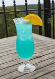 Blue Cocktail Drink with Orange Slice. Blue cocktail served on the balcony at the Crescent Hotel in Eureka Springs, Arkansas Stock Photography