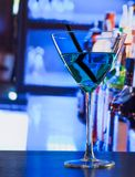 Blue cocktail drink on a wood table Stock Photos