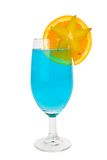 Blue cocktail with a fruit garish. Blue cocktail with a star fruit and orange garish isolated on white with clipping path stock photography