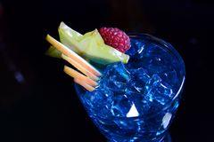 Blue mint juice with fruits and ice cubes stock image