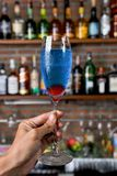 Blue cocktail in glass. Blue cocktail and cherry in glass Stock Image