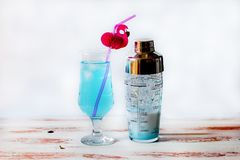 Blue cocktail in a glass glass stock image