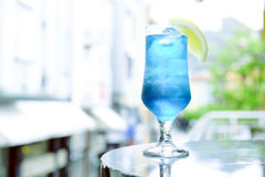 Blue Cocktail with blue curacao. Glass of Blue Cocktail on a terrace Stock Photo