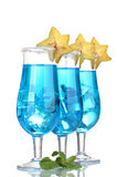 Blue cocktail in glasses with ice and sugar Royalty Free Stock Photo