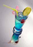 Blue cocktail with ice and lime Stock Images