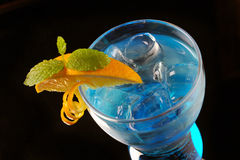 Blue cocktail with ice and orange Royalty Free Stock Image