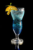 Blue cocktail with ice and orange Stock Image