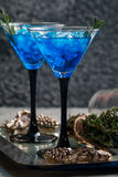 Blue cocktail with ice Stock Images