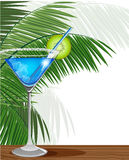 Blue cocktail with kiwi and palm branches Stock Image