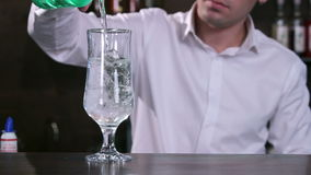 Blue cocktail with lime and ice stock video