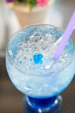 Blue cocktail martini with flower Stock Image