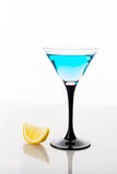 Blue cocktail in martini glass Royalty Free Stock Image