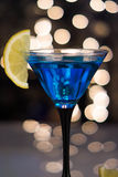 Blue cocktail in martini glass with slice of lemon Stock Photography
