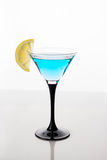 Blue cocktail in martini glass Royalty Free Stock Photography