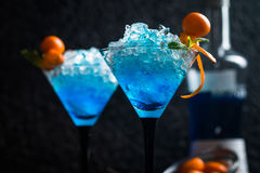 Blue cocktail in martini glasses Royalty Free Stock Image