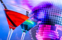 Blue cocktail with sparkling disco ball background with space for text Royalty Free Stock Photos