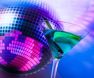 Blue cocktail with sparkling disco ball background with space for text. Dance disco concept Royalty Free Stock Photography
