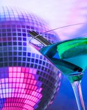 Blue cocktail with sparkling disco ball background with space for text Stock Photography