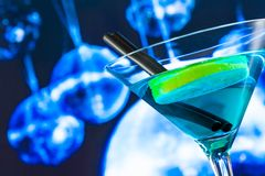 Blue cocktail with sparkling disco ball background with space for text Stock Photos