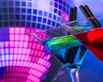 Blue cocktail with sparkling disco ball background with space for text selected focus Stock Photo