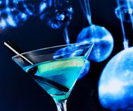 Blue cocktail with sparkling disco balls background disco atmosphere stock photos