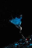 Blue cocktail splash and cherry Stock Photo