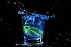 Blue cocktail splash in a glass Royalty Free Stock Images