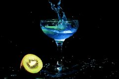 Blue cocktail splash in a glass. With kiwi Stock Photography