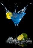 Blue cocktail splash Stock Images