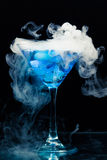 Blue cocktail with splash. And ice vapor Royalty Free Stock Photo