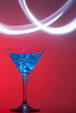 Blue cocktail with splash of light on red Stock Photos