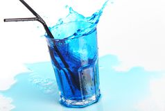 Blue cocktail with splashes isolated on white Stock Photo