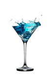 Blue cocktail with splashes isolated on white Royalty Free Stock Photos