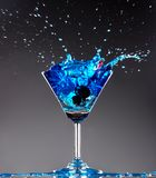 Blue cocktail splashing Stock Photos