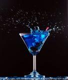 Blue cocktail splashing Stock Photos