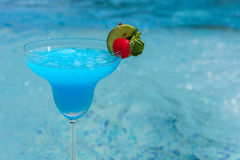 Blue cocktail on swimming pool side Stock Image
