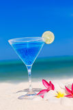 Blue cocktail at tropical beach Royalty Free Stock Image