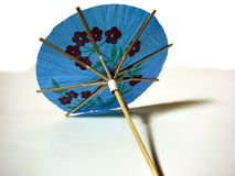 Blue cocktail umbrella Stock Images
