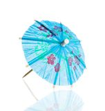 Blue cocktail umbrella isolated against white background Stock Photo