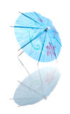 Blue Cocktail Umbrella With Reflection Royalty Free Stock Photography