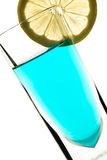 Blue cocktail with yellow lemon Royalty Free Stock Image