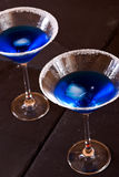 Blue cocktails. Closeup of two blue drinks in cocktail glasses Royalty Free Stock Photo