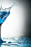 Blue coctail splash Royalty Free Stock Photos