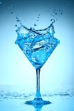 Blue coctail splash Royalty Free Stock Images