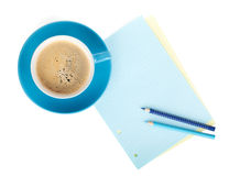 Blue coffee cup, blank paper and two pencils Stock Photo