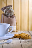 Blue coffee cup with cookies and bag Royalty Free Stock Photos