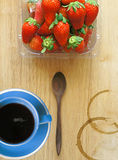 Blue coffee cup with fresh strawberries Royalty Free Stock Photography