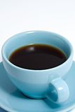 Blue Coffee Cup Full of Coffee. Close up shot of an blue coffee cup and saucer, containing black coffee Royalty Free Stock Photos